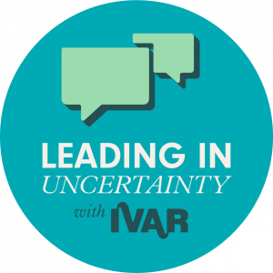 Teal badge with mint speech bubbles. Text: Leading in uncertainty with IVAR.
